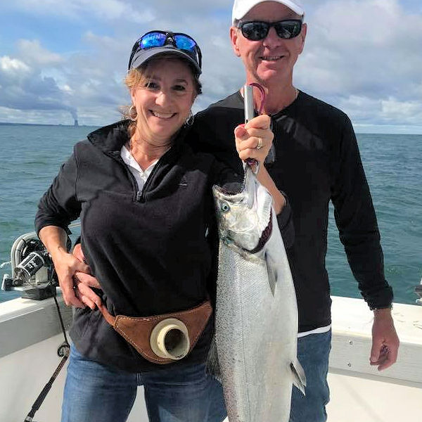 Proud anglers with large Lake Ontario king salmon.