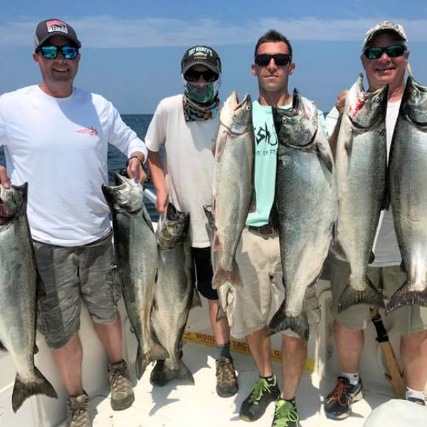 The only thing better than catching a Lake Ontario king salmon is everyone in a group catching several.